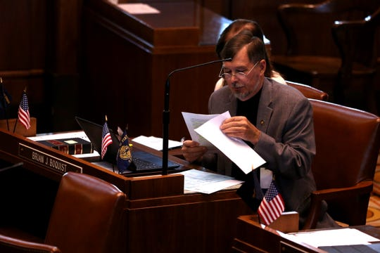Sen. Brian Boquist, R-Dallas, reads over bills on the last day of the 2019 legislative session at the Oregon State Capitol in Salem on June 30, 2019.