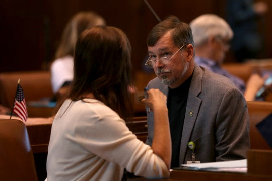 Sen. Brian Boquist, R-Dallas, speaks to his wife, legislative staffer Peggy Boquist, on the last day of the 2019 legislative session at the Oregon State Capitol in Salem on June 30, 2019.