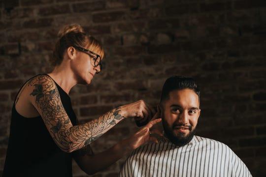 Lelyn Furey trims and styles David Castillon-Mendoza's hair for his wedding. June 29, 2019.