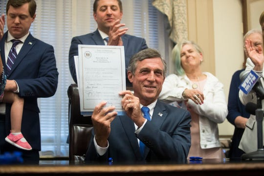 Governor John Carney signs a bill during the last day of legislative session Sunday, June 30 at Legislative Hall.