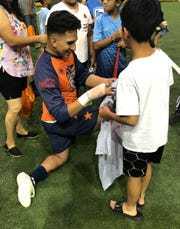 Flyers goalie Carlos Gonzalez signs autographs after Saturday's 9-2 win over Lubbock.
