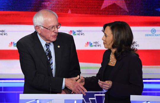 Bernie Sanders and Kamala Harris after the second Democratic primary debate on June 27, 2019, in Miami.