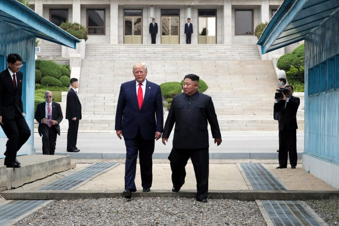 North Korean leader Kim Jong Un and  President Donald Trump inside the demilitarized zone (DMZ) separating the South and North Korea on June 30, 2019 in Panmunjom, South Korea.