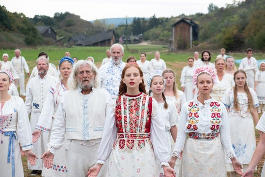 "Maja (Isabelle Grill, center) and the Harga have some strange traditions in their isolated Swedish village in ""Midsommar."""