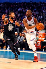 Kemba Walker and Kyrie Irving during the All-Star Game.