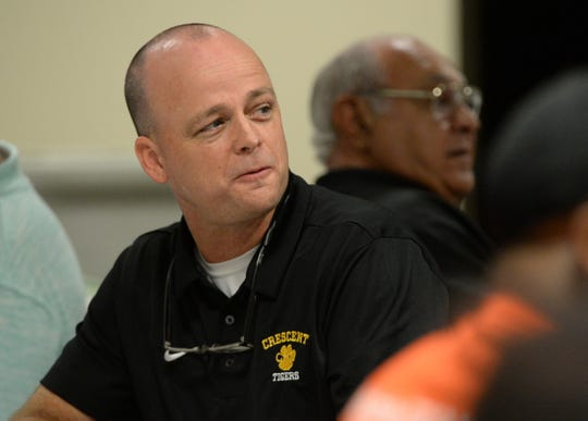 Athletic Director Jeff Craft of Crescent High School listens as Clemson assistant coach with offensive lineman Robbie Caldwell spoke at the Anderson Touchdown Club weekly meeting in the Anderson County Main Library in Anderson on Friday, September 28, 2018.