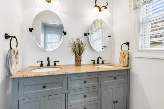 The Master bath offers his and her sinks  and private deck