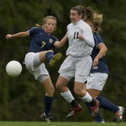Freehold Boro's Kelsey Holz (7) and Red Bank Regional' s Erin Simon (11) fight for ball during first half action of Freehold Boro vs Red Bank Regional Girls Soccer on Oct. 14, 2009