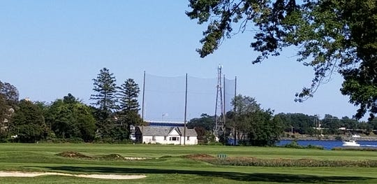 One resident's giant golf net along the Manasquan River Golf Club is drawing opposition from neighbors who call it an eyesore.