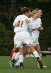 Jackson Liberty at Red Bank Regional soccer in CJ III playoffs on Nov. 2, 2009. RB #11 Erin Simon congratulates. #16 Emily Boehler on her goal.