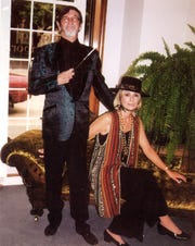 Clint Hamilton and Tootsie Nichols putting on the ritz for a 1998 art and fashion show at The Center for Contemporary Arts.