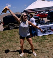 Jodi Hierholzer performs her version of an end zone dance after scoring a bullseye with her ax, despite not getting a hit eight or so times before Saturday at Sockdolager Brewing Company. Abilene Axe Company brought their custom trailer for Sockdolager customers to try their hand at ax throwing.