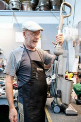 Tom DuVall in the repair room at Saniway Vacuum Cleaner Company on Haywood Road in West Asheville July 1, 2019.