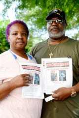 Charlotte and Rev. Eddie Tolbert hold fliers on the year anniversary of their grandson's shooting death July 1, 2019.