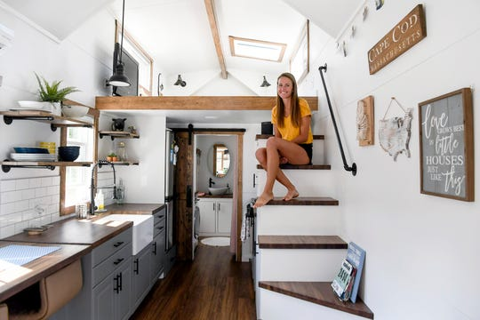 Jacki Cronin sits on the stairs in her tiny home in Hendersonville May 28, 2019.