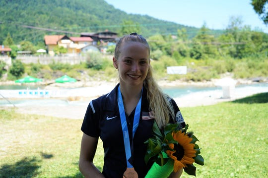 Evy Leibfarth, 15, of Bryson City became the youngest woman to medal at an ICF Slalom Canoe senior world cup. Here she poses with her medal June 30 in Slovenia.