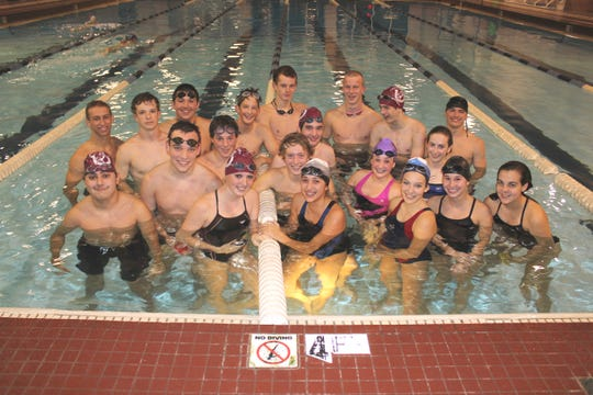 In this 2011 file photo, the Owen High swim team poses for a photo in what was their home pool at Warren Wilson College during a recent practice.The pool has been closed for renovations since 2014.