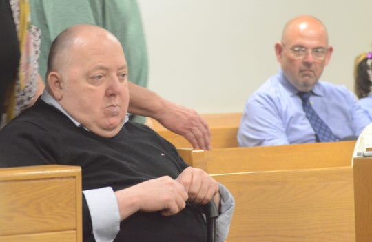 Kevin Frederick, in a wheel chair, is brought into the courtroom on Monday.