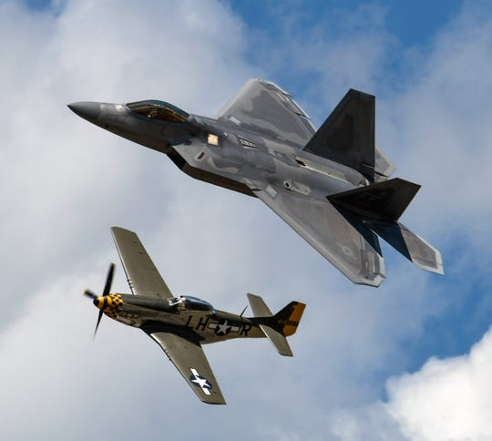 The P-51 Mustang joins the sky with the F-22 Raptor during the Heritage Flight over the Field of Flight on July 1, 2017. The F-22 flies again this year in Battle Creek.
