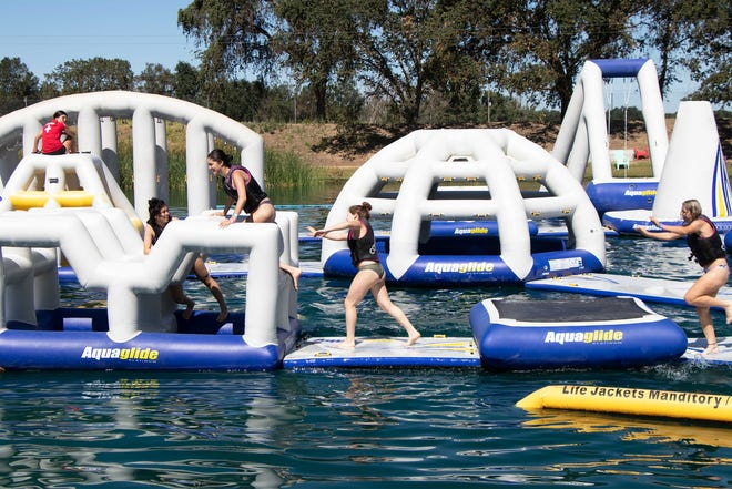 An aquatic playground, like this one at Velocity Island Cable Park in Woodland, California, is expected to open in Coldwater Township in 2020.