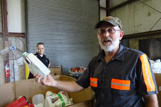Randy Burton holds up a plastic bottle that's too dirty to be recycled. Workers at the Crawford County Recycling Center would like residents to better understand which items can and cannot be recycled.