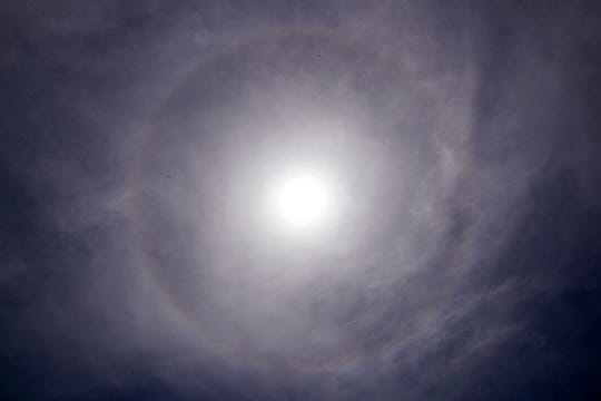 A rare meteorological event happened Monday, July 1, 2019, in which a halo appeared around the sun. The phenomenon happens when sunlight refracts off ice crystals in a thin veil of cirrus clouds, according to the National Weather Service.
