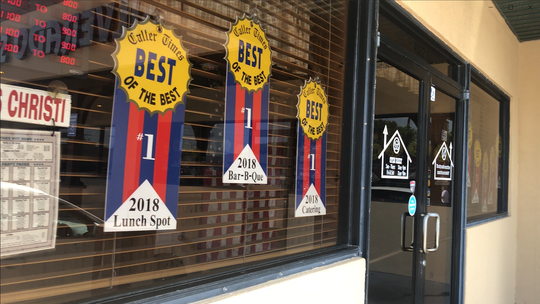 Silverado Smokehouse presents its Best of the Best awards in its front windows.