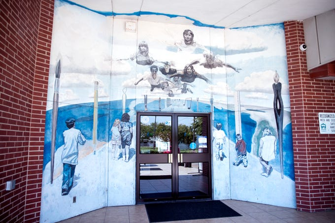There are several murals located at the Antonio E. Garcia Arts & Education Center. This mural at the entrance was created by artist Jimmy Pena.