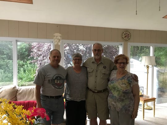 Gordon Bocher (left), Ria Korsholm Madsen, Sten Boye Poulsen and Betsy Bocher are shown in the Bocher's Marlton home recently. Sten, who is from Denmark, and Betsy became pen pals nearly 60 years ago from the back of a comic book and have kept in touch over the years.