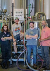 From left, CollaborAid partners include J.T. Melvin from Double Nickel, Eli Facchinei and Mike Nuhn from Tonewood Brewing Company and Drew Perry from Double Nickel.