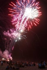 Fireworks light up the beach during a Seaside Heights Fourth of July celebration.