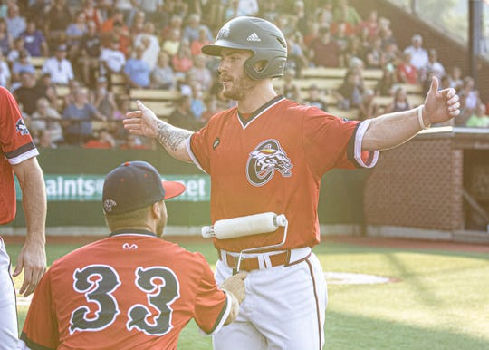 Chris Eisel celebrates scoring a run against the Terre Haute Rex on June 29 at VA Memorial Stadium. Eisel hit a solo home run in the Paints 5-2 game three win in the Prospect League Championship series on Tuesday.
