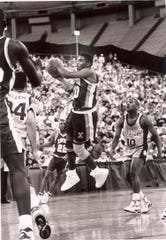 Xavier University point guard Jamal Walker looks to make a pass against Georgetown in the second round of the 1990 NCAA Tournament at the RCA Dome in Indianapolis.