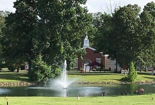 The Arlington Memorial Gardens has a chapel on a small lake.