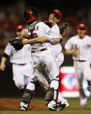July 2, 2013: Reds pitcher Homer Bailey celebrates completing a no-hitter with catcher Ryan Hannigan.