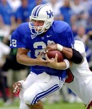 Sept. 1, 2001: Kentucky quarterback Jared Lorenzen tries to escape the grasp of Louisville defender Jason Spitz, during the first half in Lexington, Ky.