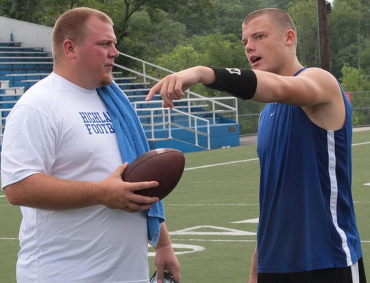 July 21, 2010: Highlands High School new quarterbacks coach Jared Lorenzen, left, talks to the Bluebirds starting quarterback Patrick Towles.
