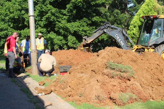 Workers from Clarksville Gas & Water repair a burst 18-inch gravity sewer main in a north Clarksville neighborhood Friday, June 28, 2019.