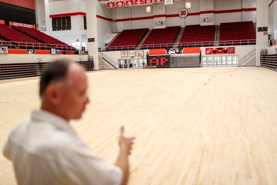 Austin Peay State University facilities coordinator Bud Jenkins motions toward the basketball court's surface that had been mostly sanded away at the Dunn Center on Monday, July 1, 2019.
