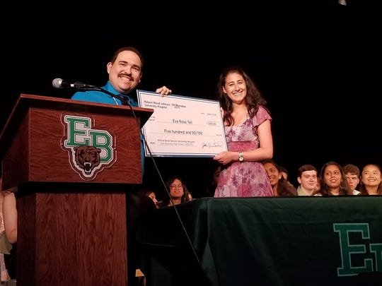 Michael Leviton, business development manager, Robert Wood Johnson Blood Services, presents scholarship check to Eva Rose Tell, who will attend the University of Maryland, College Park this fall.