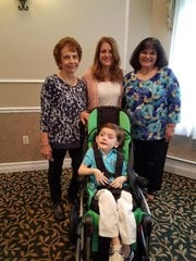 Dylan Vonrej with his nurses Kathy, Darlene and Terry.