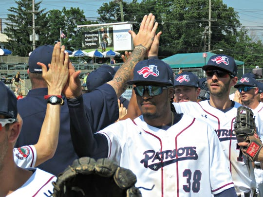 Jimmy Paredes (38) and Will Kengor (7) celebrate the Somerset Patriots' win on Sunday.