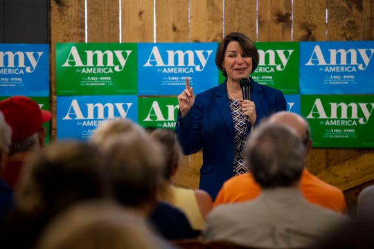 U.S. Sen. Amy Klobuchar, D-Minn., speaks to the crowd of people gathered inside the Northside Cafe during a campaign visit on Monday, July 1, 2019, in Winterset.
