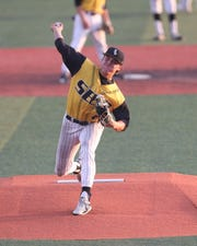 Southeast Polk's Adam Schneider delivers a pitch during a June 24 game against Marshalltown at Southeast Polk High School.
