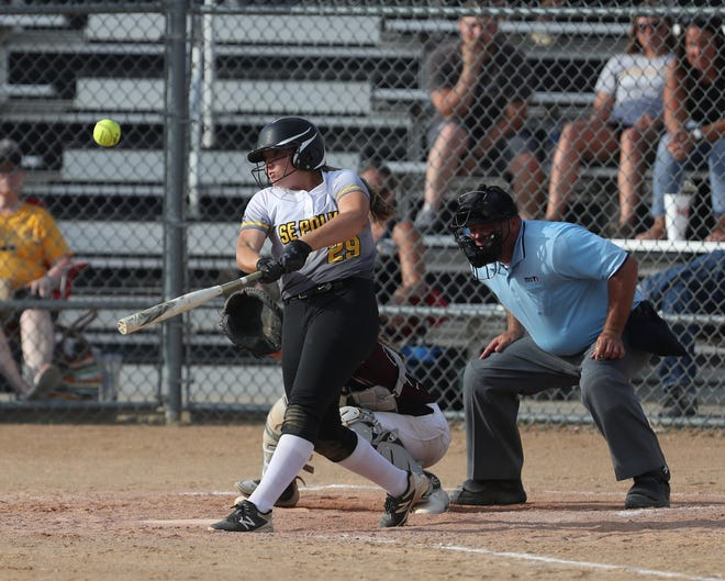 Southeast Polk's Sydney Potter crushes a home run during a June 27 game against Dowling Catholic at Southeast Polk High School. Potter, an incoming freshman, has 8 home runs in just 17 games this season.
