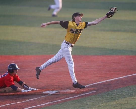 Southeast Polk's Calvin Harris saves an over-throw during a June 24 game against Marshalltown at Southeast Polk High School.