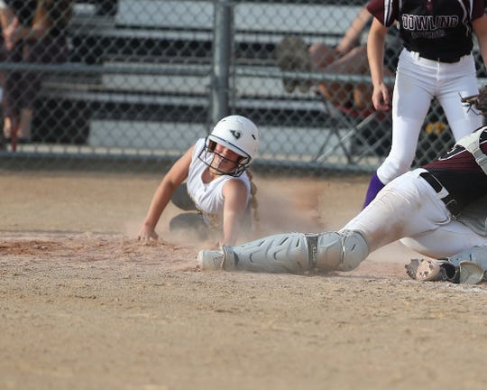 Southeast Polk's Kaysee Dale tags home during a June 27 game against Dowling Catholic at Southeast Polk High School.