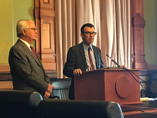 Rep. John Forbes, D-Urbandale (left) and state Sen. Joe Bolkcom, D-Iowa City, speak on Monday, July 1, 2019 at a news conference calling for a committee of lawmakers to study how to improve the state's medical marijuana program.