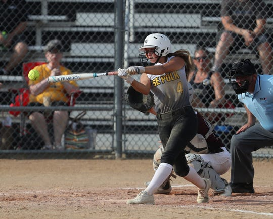 Southeast Polk's Abbi Cataldo gets a hit during a June 27 game against Dowling Catholic at Southeast Polk High School. Cataldo has 8 home runs this season.