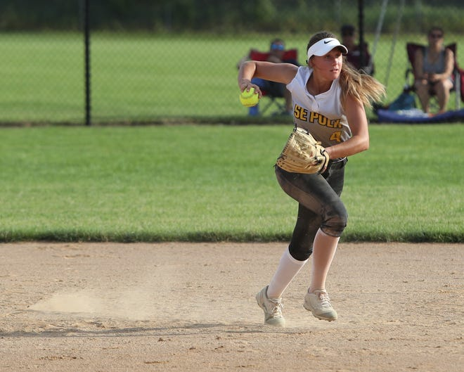 Southeast Polk's Abbi Cataldo fields a ground ball during a June 27 game against Dowling Catholic at Southeast Polk High School.
